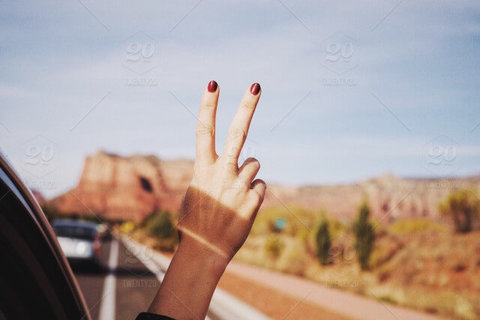 Medium stock photo road road trip desert hand freedom peace sign route grain southwest 55c8d707 c509 419f 8c23 095e1afaa984