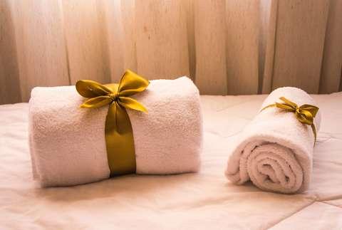 Medium bath towels bed close up 1304110